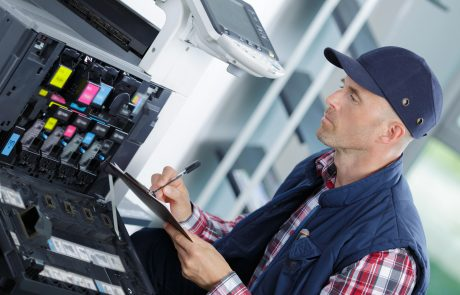 technician fix office photo copier