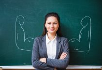 smiling teacher near the board