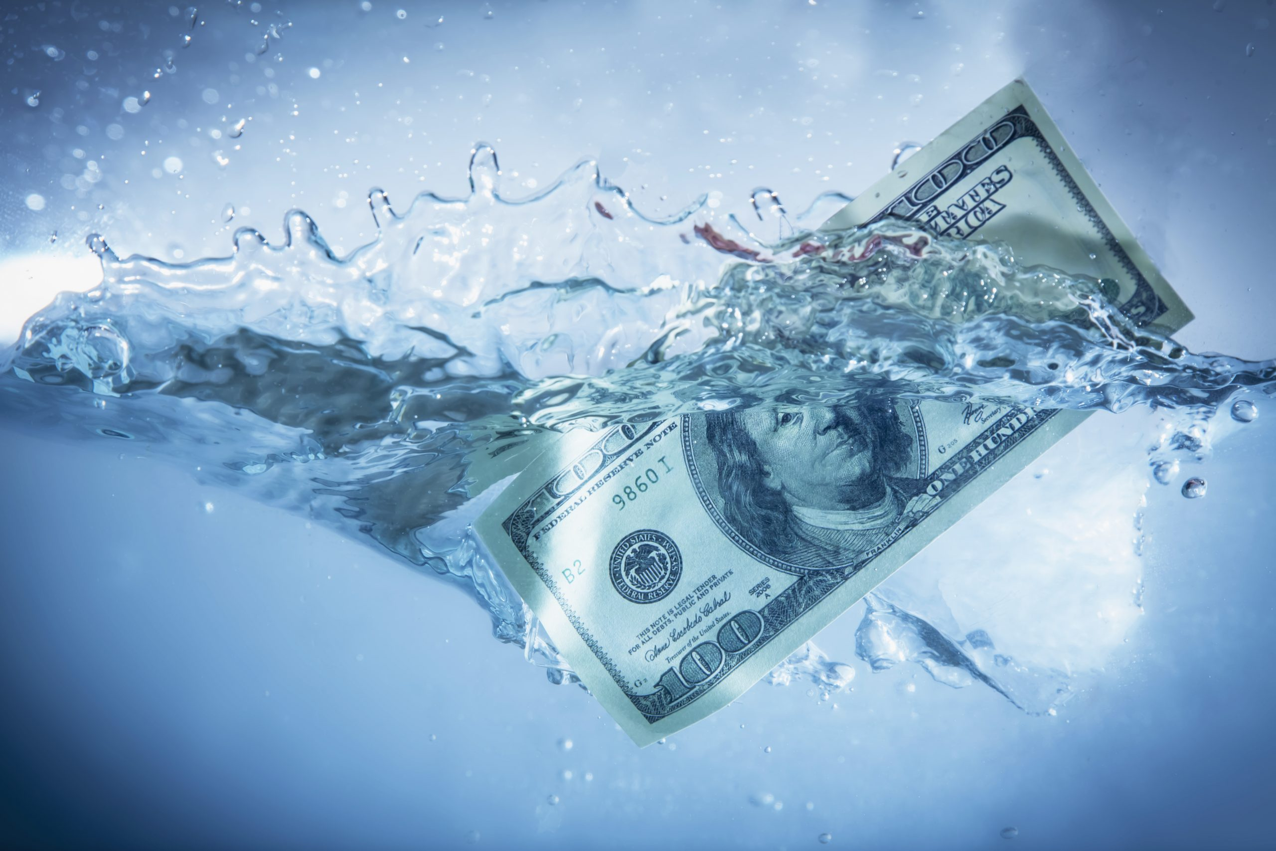 Global financiall crisis concept. US Dollar sinking in water