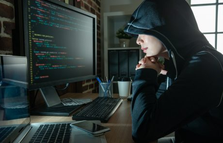 female hacker staring at the screen smiling.