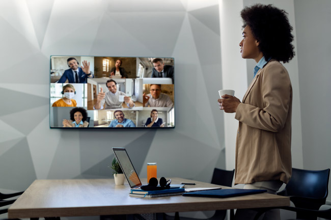 A remote team on call via UCaaS and a VoIP system
