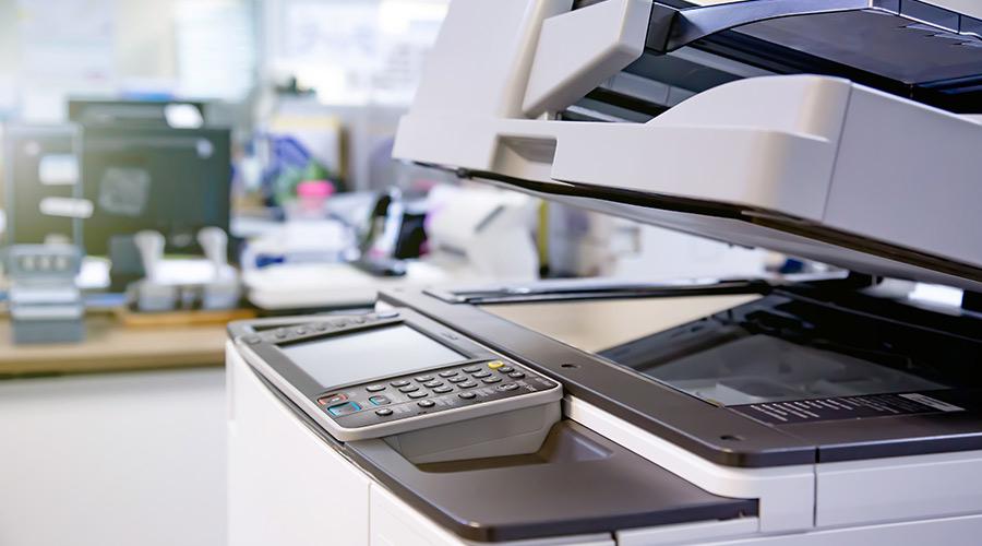 a macro shot of a printer to represent school office equipment