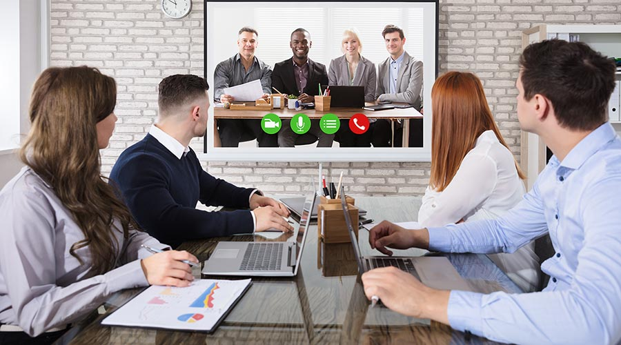 a team on a web conference call using a video conferencing software