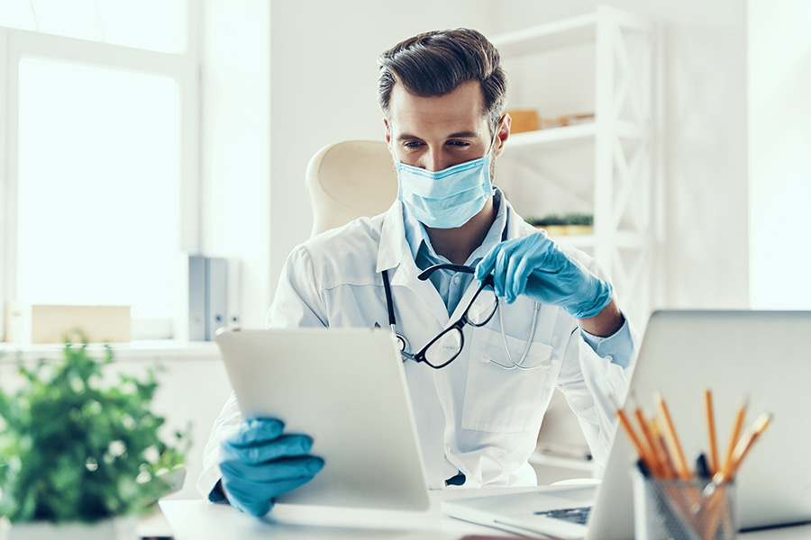 A doctor looking at patient's health records stored in HIPAA-compliant cloud server