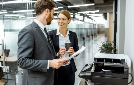 Man and woman in business suits discussing the costs and benefits of copier lease