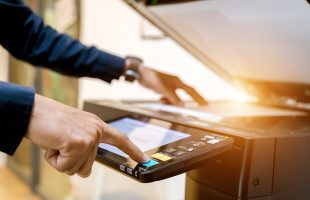 Man using a copier: hero image for Managed print solutions blog