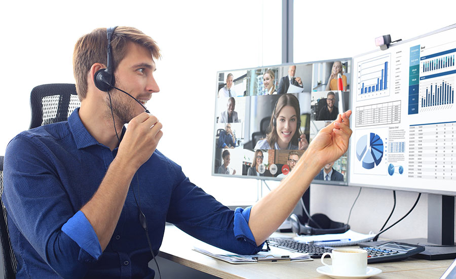 A man using video conferencing