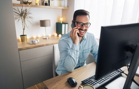 Man using his VoIP solution at a home office